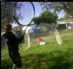 Olympic Torch Relay Event - coach Andy tests out the speed gun with the giant racket!