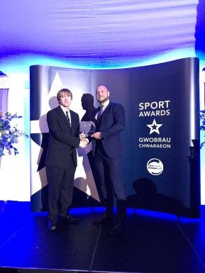 Sport Caerphilly Sport Awards 2018 - Head Coach Jonathan Morgan wins Community Coach of the Year Award, presented by Richard Rees